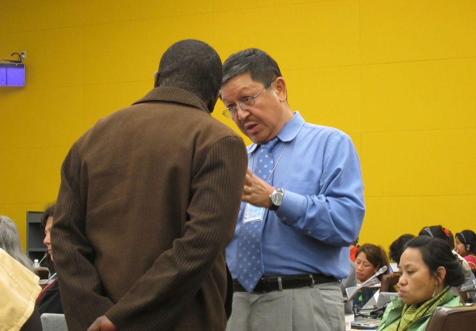 Navin Rai (right), the World Bank's top advisor on indigeneous peoples affairs from 2000 to 2012, talks with a member of the