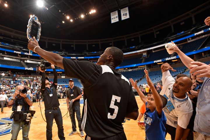 "The Orlando Magic's Victor Oladipo poses for a ""Twitter Mirror"" photo with fans during an open practice on Oct. 5,"