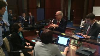 Representative Greg Foster talks with attendees of the second Congressional hackathon in the U.S. Congress