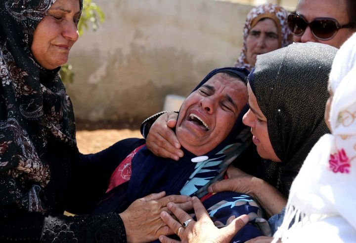 Relatives mourn during the Aug. 8, 2015, funeral of Saad Dawabsheh, the father of a Palestinian toddler burned to death