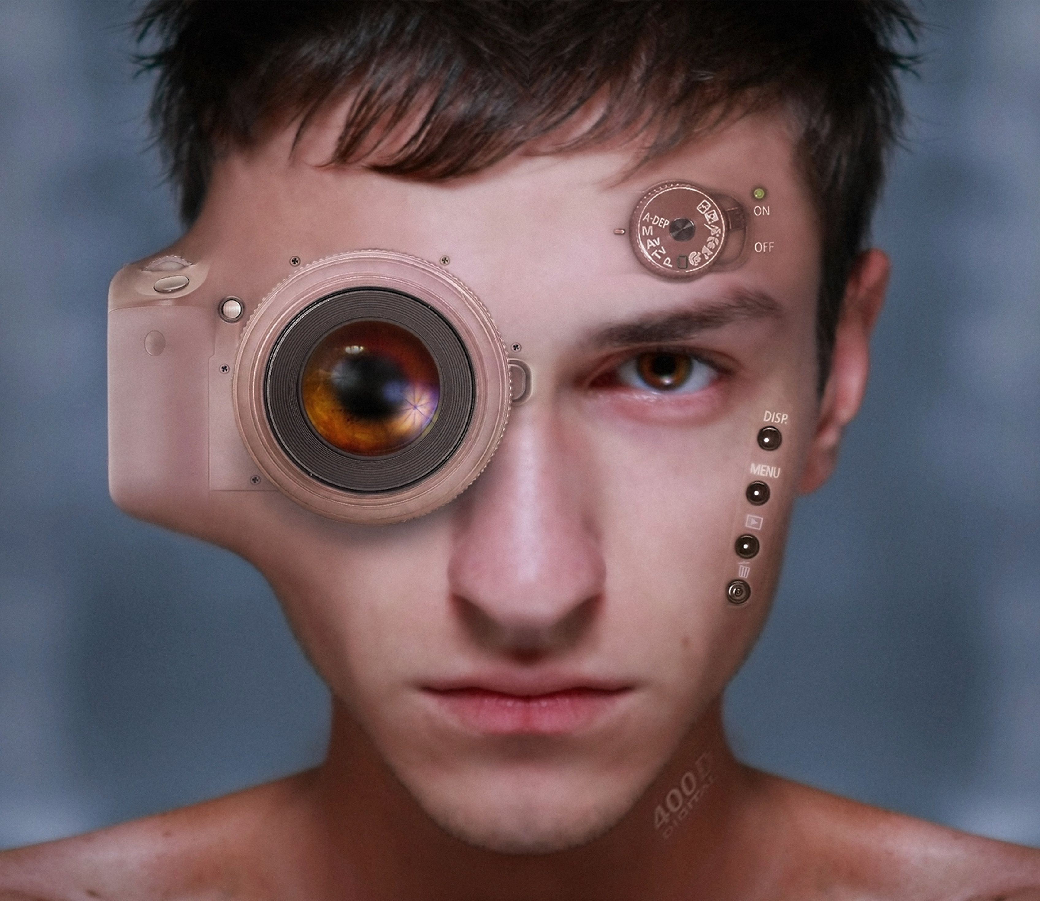 A young man with a camera embedded in his face