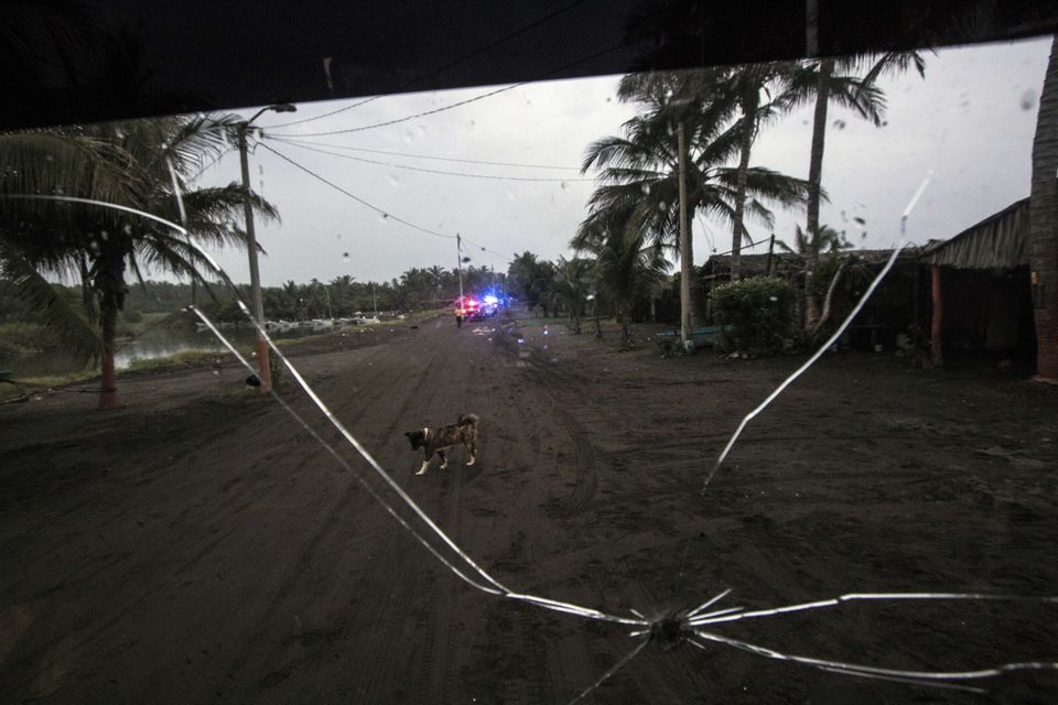 View of street at Boca de Pascuales community as residents are evacuated by local authorities before the arrival of hurricane