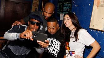 WASHINGTON, DC - OCTOBER 22:  (L to R) Brother Marquis of 2 Live Crew, Darryl 'DMC' McDaniels of Run DMC, Fresh Kid Ice of 2 Live Crew and Ashley Spillane, President, Rock the Vote, take a selfie backstage at Rock The Vote's #TBT 25th Anniversary Concert at The Black Cat on October 22, 2015 in Washington, DC.  (Photo by Paul Morigi/WireImage)