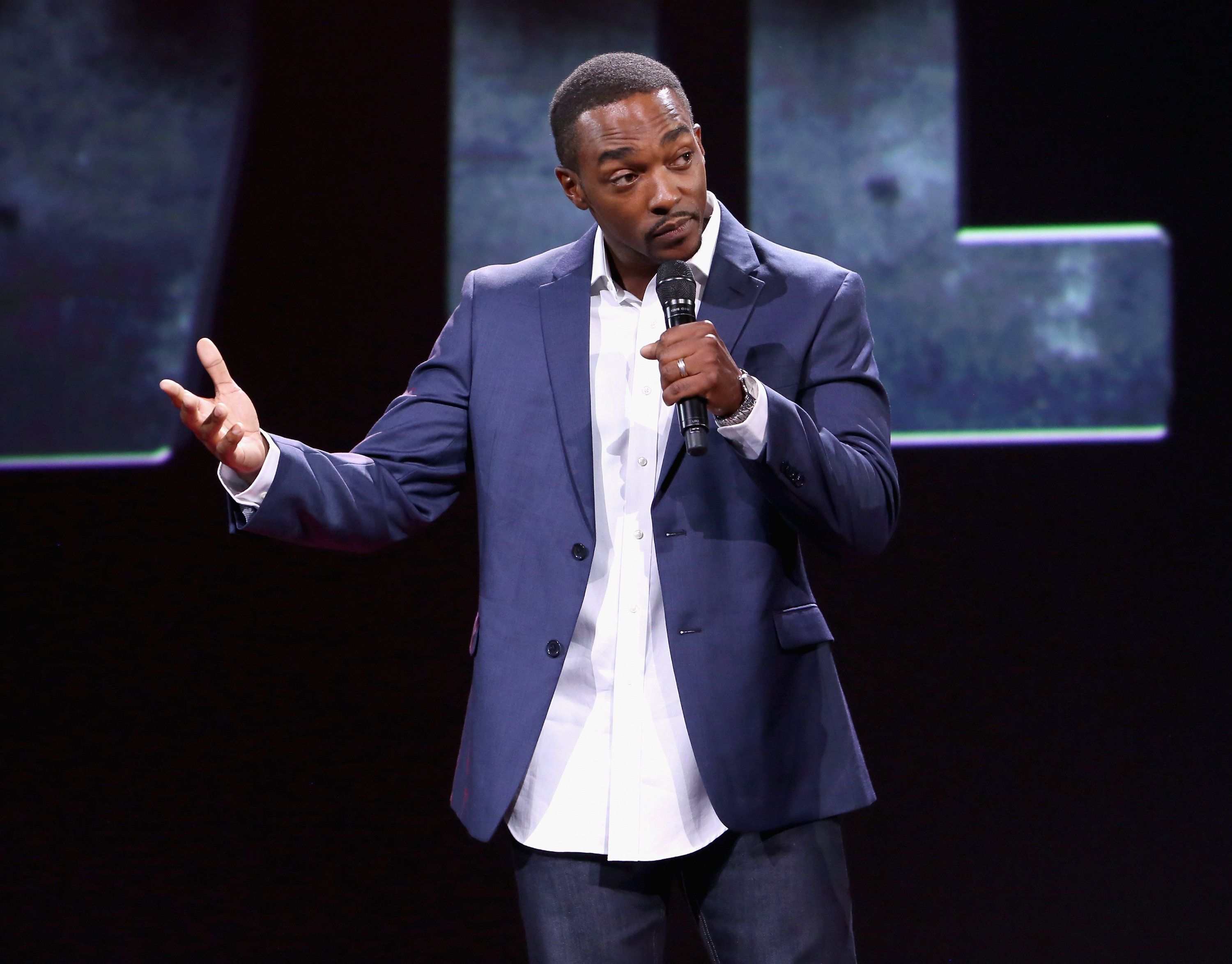ANAHEIM, CA - AUGUST 15:  Actor Anthony Mackie of CAPTAIN AMERICA: CIVIL WAR took part today in 'Worlds, Galaxies, and Universes: Live Action at The Walt Disney Studios' presentation at Disney's D23 EXPO 2015 in Anaheim, Calif.  (Photo by Jesse Grant/Getty Images for Disney)