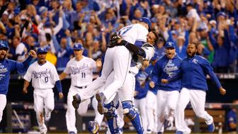KANSAS CITY, MO - OCTOBER 23:  Wade Davis #17 and Salvador Perez #13 of the Kansas City Royals celebrate after the Royals 4-3 victory against the Toronto Blue Jays in game six of the 2015 MLB American League Championship Series at Kauffman Stadium on October 23, 2015 in Kansas City, Missouri.  (Photo by Rob Carr/Getty Images)