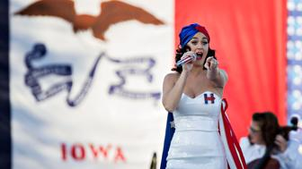 Singer Katy Perry performs during a rally for Hillary Clinton, former Secretary of State and 2016 Democratic presidential candidate, not pictured, ahead of the Jefferson-Jackson Dinner in Des Moines, Iowa, U.S., on Saturday, Oct. 24, 2015. Clinton's odds of winning the Democratic presidential nomination are now at or near an all-time high, according to prediction markets PredictWise, Pivit, and PredictIt. Photographer: Daniel Acker/Bloomberg via Getty Images