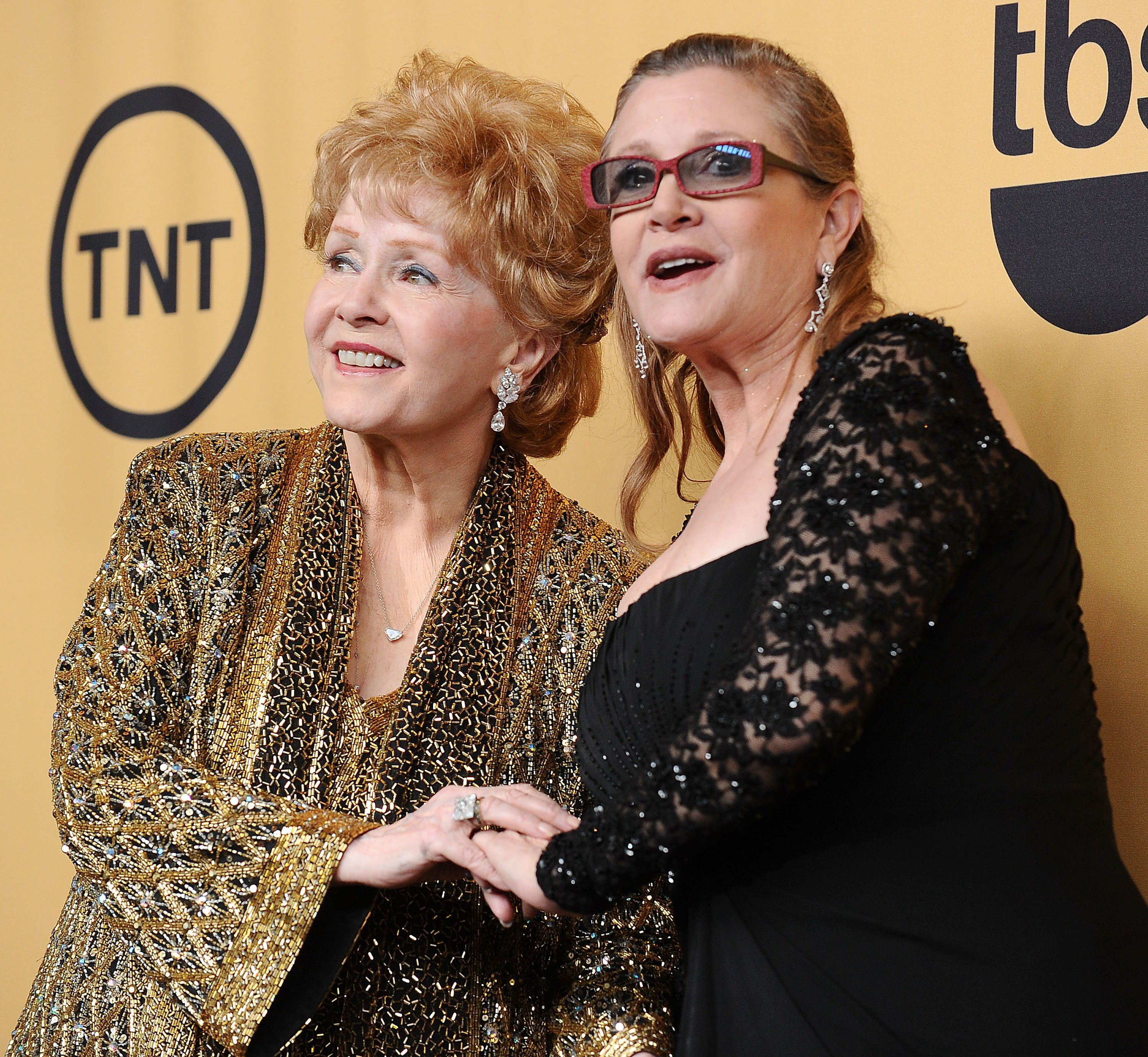 LOS ANGELES, CA - JANUARY 25:  Actresses Debbie Reynolds and Carrie Fisher pose in the press room at the 21st annual Screen Actors Guild Awards at The Shrine Auditorium on January 25, 2015 in Los Angeles, California.  (Photo by Jason LaVeris/FilmMagic)
