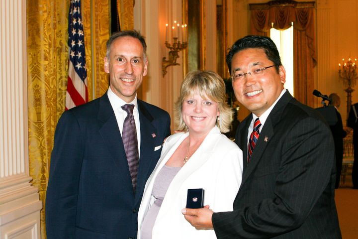Jack Hawkins, Director of USAID with Julie Hiramine and Kay Hiramine of Colorado Springs, Colo., recipient of the President's