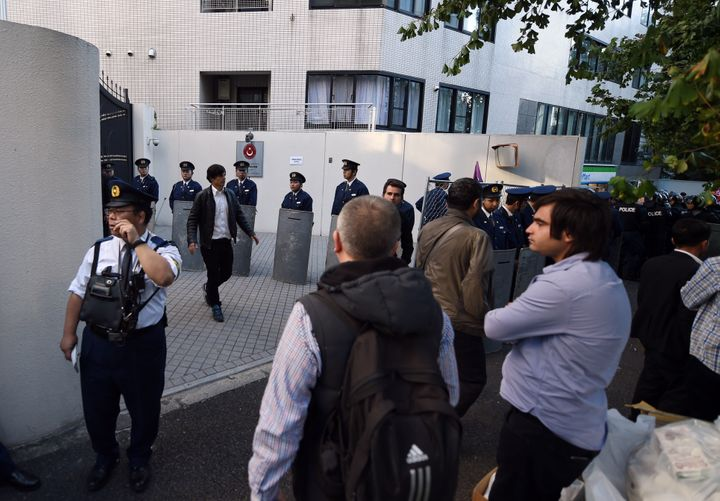 Riot police officers stand guard in front of the Turkish embassy in Tokyo on October 25, 2015.