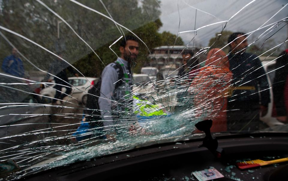 A car's windscreen in Srinagar, Kashmir, is damaged after a powerful earthquake struck northern Afghanistan, with tremors fel