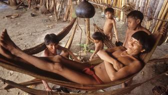 Yanomami Amerindians, Venezuelan Amazonas, Serra Parima, Orinoco River Basin, Yanomami village, Families live in large communal homesteads, Each family has its own hearth where members eat, sleep and store belongings, Hammocks are strung one above the other like bunks with the youngest children at the bottom, Of all Amerindian tribes, the Yanomami have the least exposure to the modern world, Their future may now be threatened by diseases spread by illegal gold miners, (Photo by Universal Images Group via Getty Images)