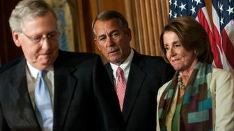 WASHINGTON, DC - APRIL 16:  (L-R) Senate Majority Leader Mitch McConnell (R-KY), House Speaker John Boehner (R-OH) and House Minority Leader Nancy Pelosi (D-CA) attend the bipartisan signing of the Medicare Access CHIP Reauthorization Act 2015, H.R. 2, press event at the Capitol on April 16, 2015 in Washington, D.C. H.R. 2, commonly known as 'Doc Fix', is  a bipartisan bill to strengthen Medicare and fix its payment formula for doctors. (Photo by Gabriella Demczuk/Getty Images)