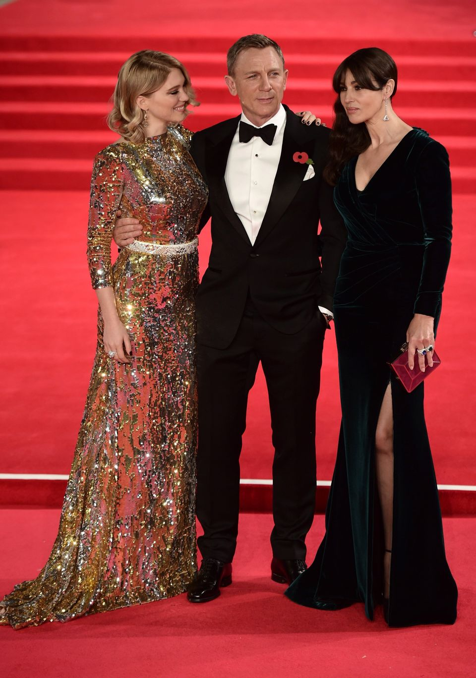(L-R) French actress Lea Seydoux, British actor Daniel Craig and Italian actress Monica Bellucci pose on arrival for the worl