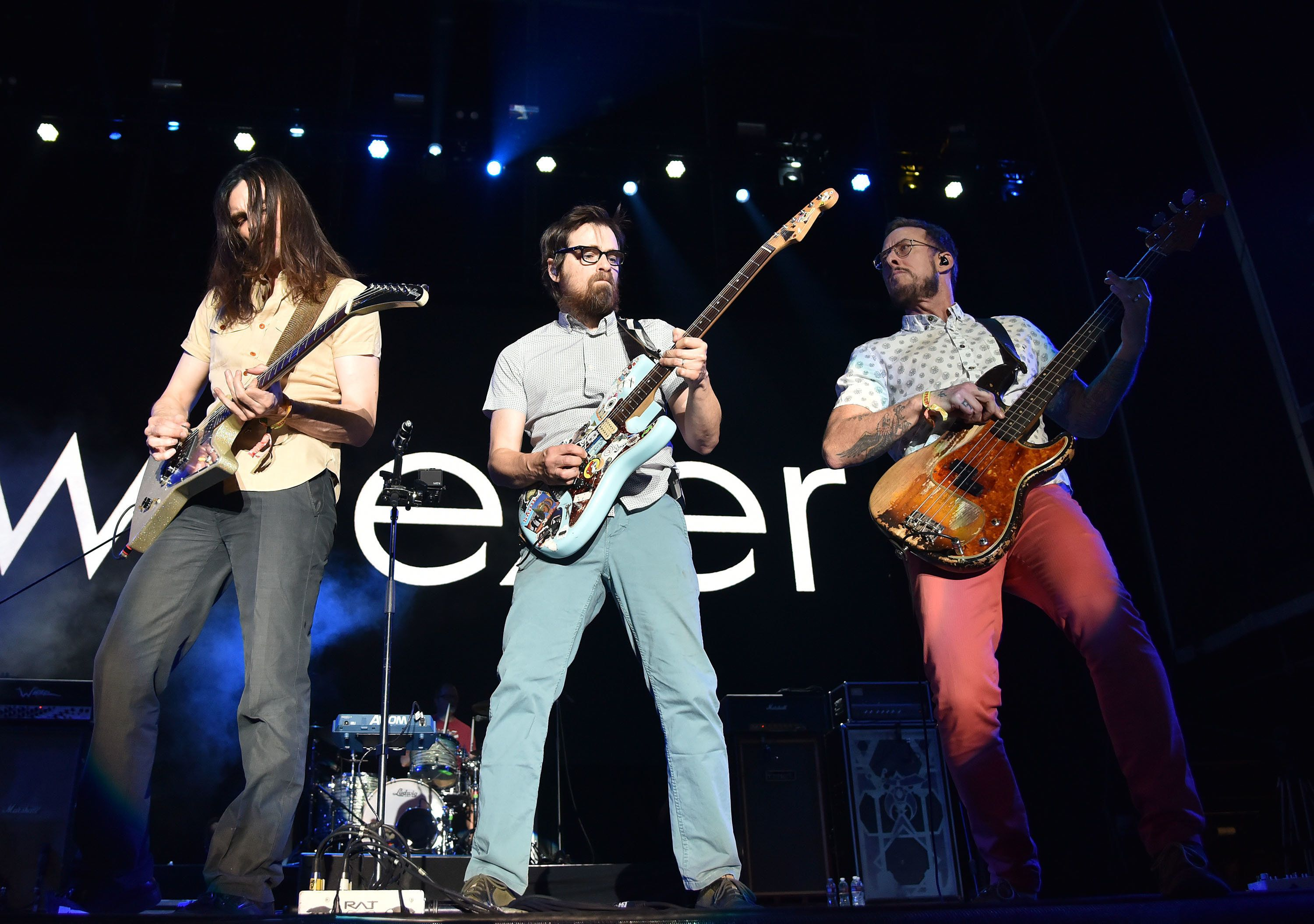 LAS VEGAS, NV - SEPTEMBER 27:  (L-R) Musicians Brian Bell, Rivers Cuomo and Scott Shriner of Weezer performs onstage during the 2015 Life is Beautiful festival on September 27, 2015 in Las Vegas, Nevada.  (Photo by C Flanigan/FilmMagic)