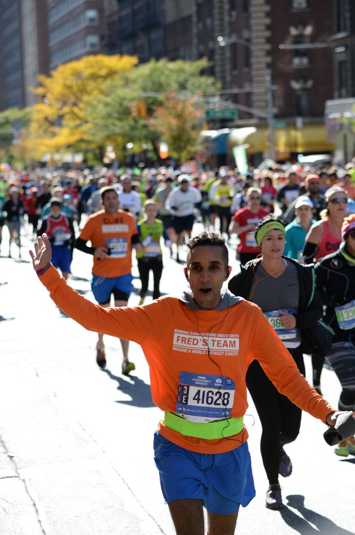 Narang celebrates in the middle of the 2014 marathon.