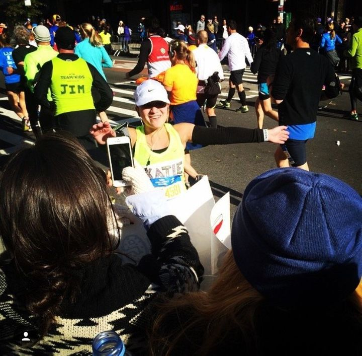 Caba finds friends and family in the crowd of the 2014 marathon.