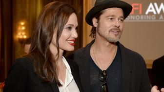 BEVERLY HILLS, CA - JANUARY 09:  Director/actress Angelina Jolie (L) and actor/producer Brad Pitt attends the 15th Annual AFI Awards Luncheon at Four Seasons Hotel Los Angeles at Beverly Hills on January 9, 2015 in Beverly Hills, California.  (Photo by Michael Kovac/Getty Images for AFI)