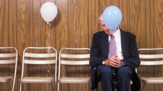 Elderly Man Holding Balloon