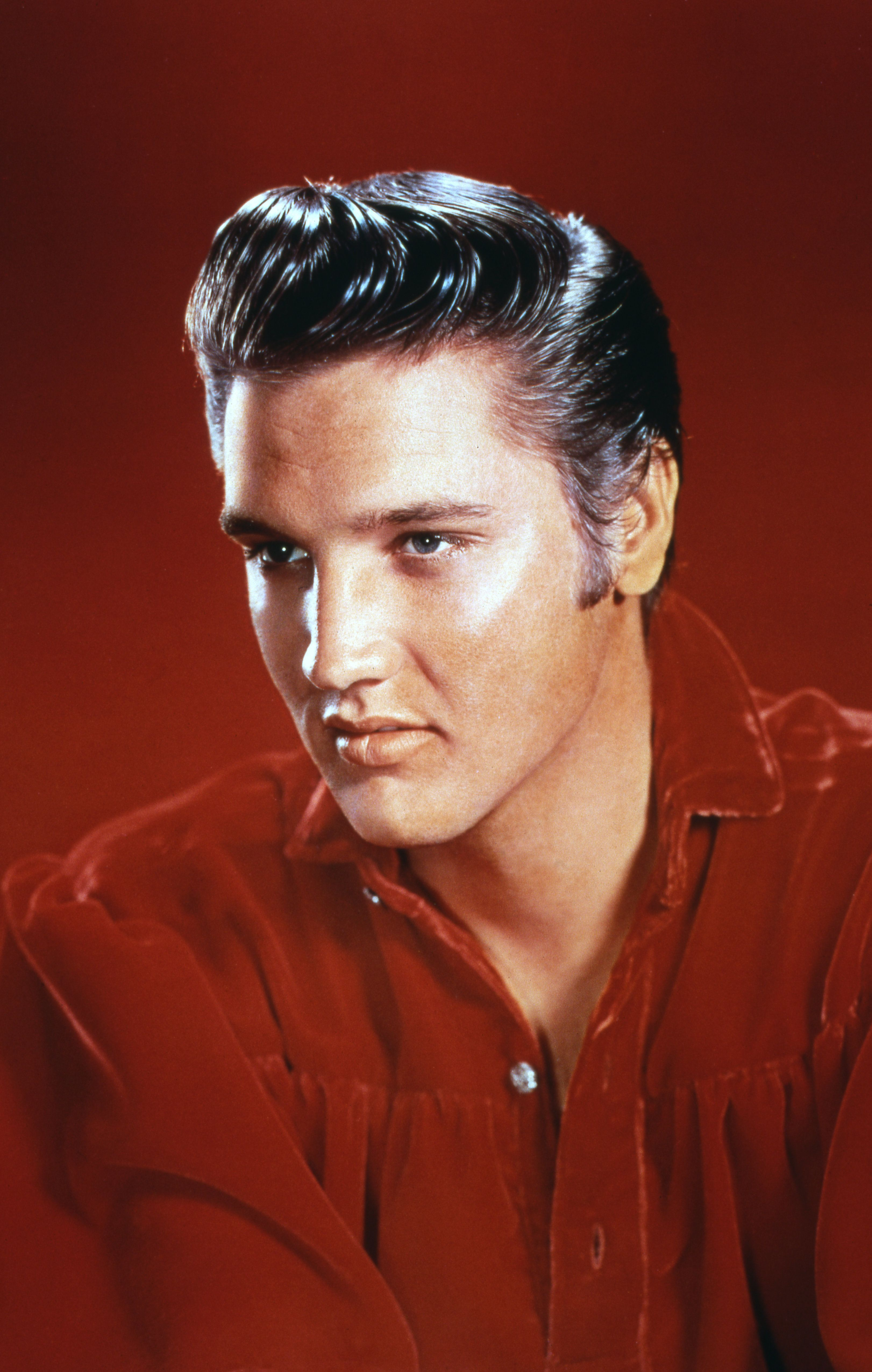 MEMPHIS, TN - 1956:  Rock and roll musician Elvis Presley poses for a portrait in Memphis, Tennessee in 1956. Photo by Michael Ochs Archives/Getty Images