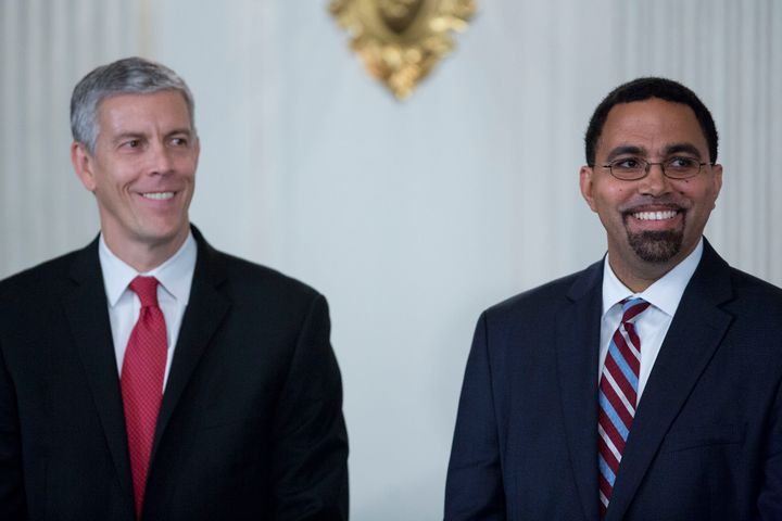 John King Jr., senior advisor at the U.S. Department of Education, right, and Arne Duncan, outgoing U.S. education secretary,