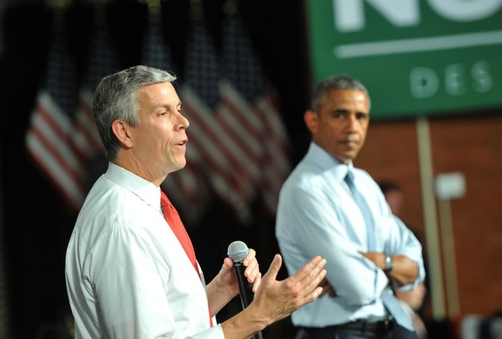 Outgoing Secretary of Education Arne Duncan speaks alongside President Barack Obama at a town hall style meeting at North Hig