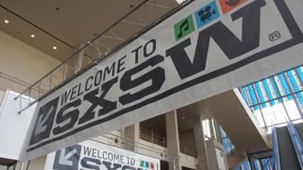 Banners hang in the atrium of the Austin Convention Center on Thursday, March 7, 2012 on the eve of the opening of the 27th South By Southwest (SXSW) interactive, film and music festival.  The 10-day event is a magnet for thousands of technology innovators, independent film-makers and up-and-coming musical performers.  AFP PHOTO / Robert MacPherson        (Photo credit should read Robert MacPherson/AFP/Getty Images)