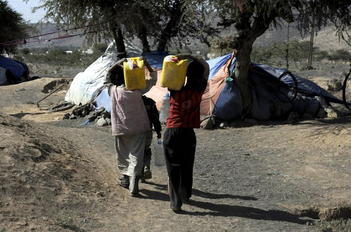 Families fleeing their homes in Saada, Yemen, due to air operations by the Saudi-led coalition live in makeshift tents near t
