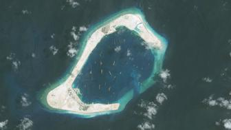 SUBI REEF, SOUTH CHINA SEA - SEPTEMBER 1, 2015:  DigitalGlobe imagery of the Subi Reef in the South China Sea, a part of the Spratly Islands group.  Image progression.  Photo DigitalGlobe via Getty Images.