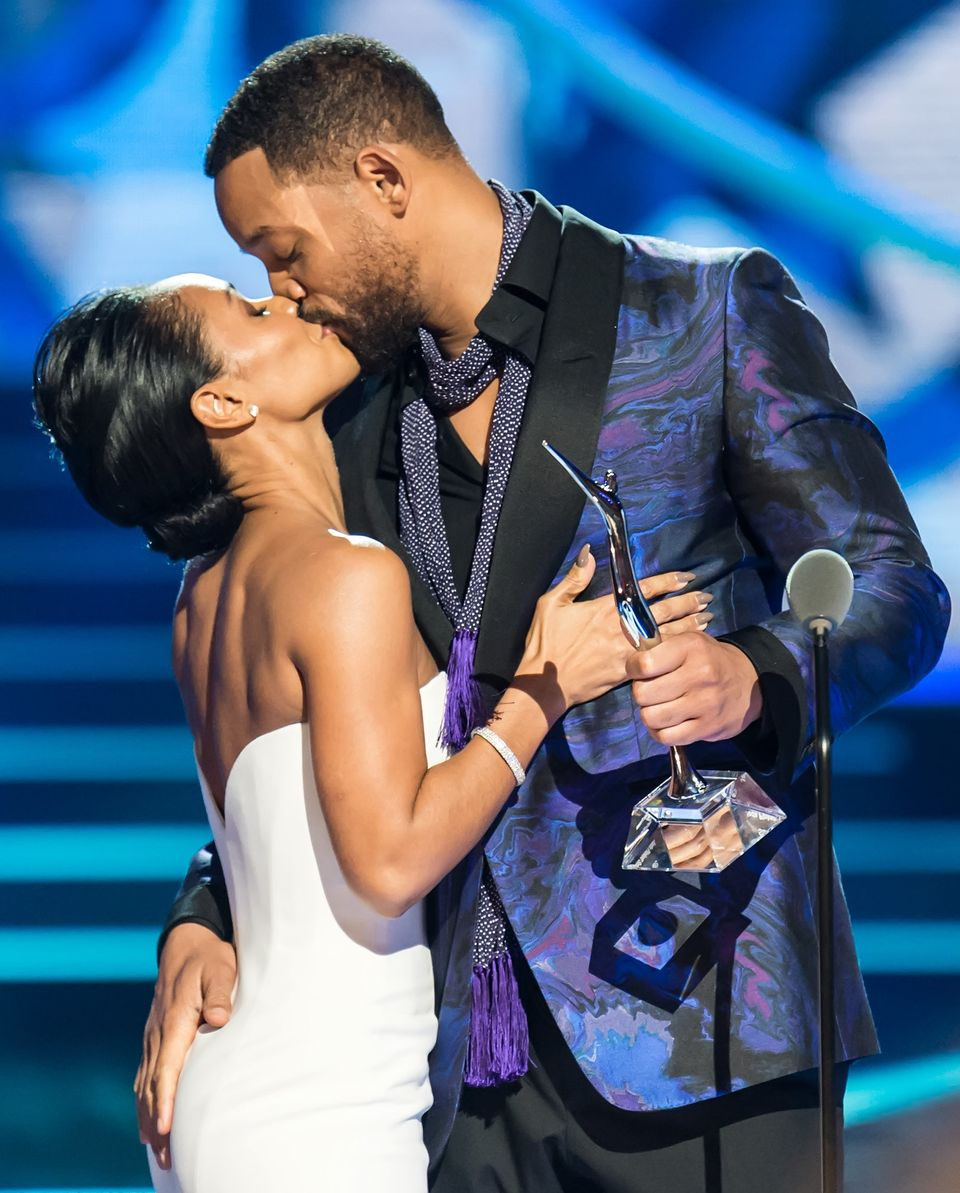 NEWARK, NJ - MARCH 28:  Actor Will Smith (R) presents his wife, actress Jada Pinkett Smith with the Star Power award  onstage