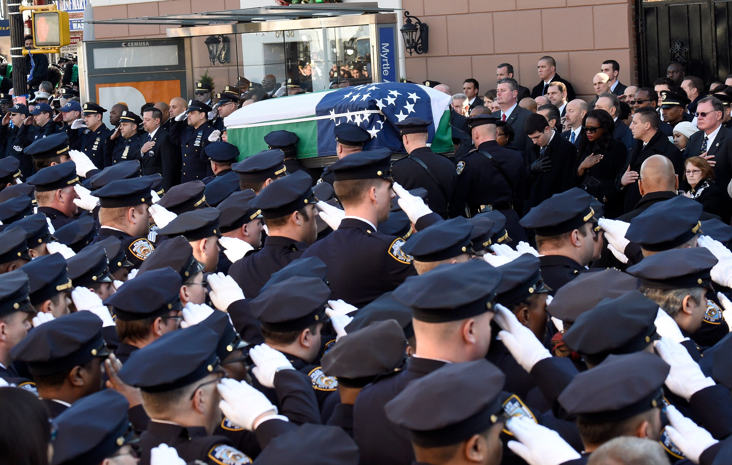 Pallbearers carry the casket at the Dec. 27, 2014, funeral of Officer Rafael Ramos, one of two police officers murdered while