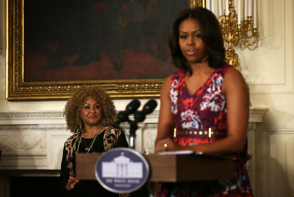 WASHINGTON, DC - APRIL 14:  U.S. first lady Michelle Obama (R) speaks as musician Darlene Love (L) listens during a workshop