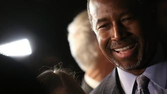 ALEXANDRIA, UNITED STATES - OCTOBER 16:  Republican presidential candidate Dr. Ben Carson greets supporters after delivering brief remarks at the King Street Retail Walk October 16, 2015 in Alexandria, Virginia. Carson discussed threats facing the United States during his remarks.  (Photo by Win McNamee/Getty Images)