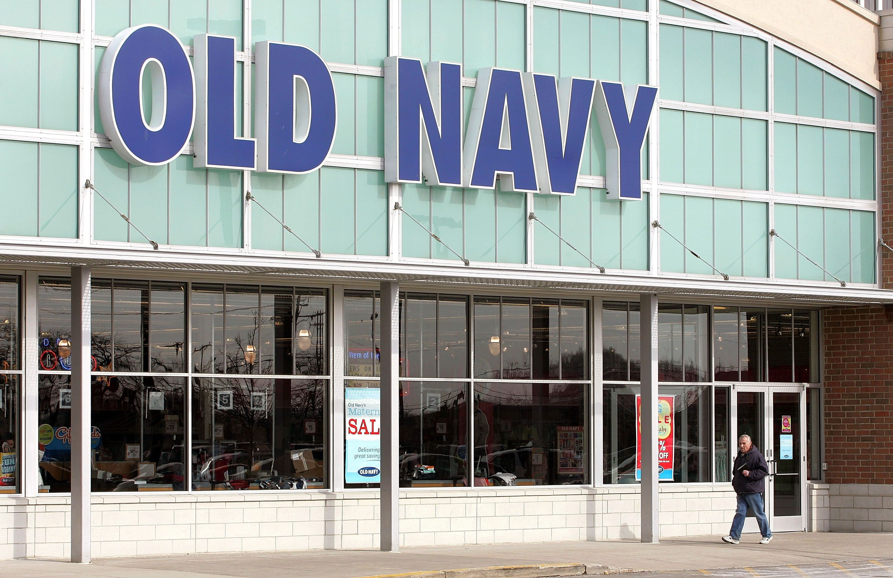 SKOKIE, IL - FEBRUARY 11:  A man walks past an Old Navy store February 11, 2005 in Skokie, Illinois. Old Navy has announced that it is expanding its new Women's Plus line to more locations including this select suburban Chicago store. The clothing company says their new spring product line offers the plus-sized woman great-fitting clothing and affordable fashion. Old Navy operates more than 850 stores in the United States and Canada.  (Photo by Tim Boyle/Getty Images)