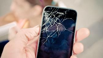 Shattered glass of a beloved smartphone.