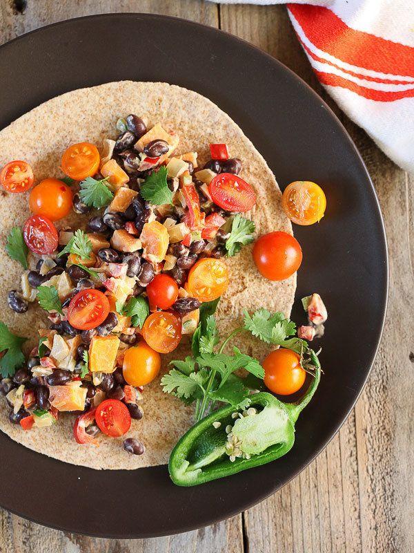 "<strong>Get the <a href=""http://www.foodiecrush.com/sweet-potato-black-bean-burritos/"">Sweet Potato And Black Bean Burrito re"