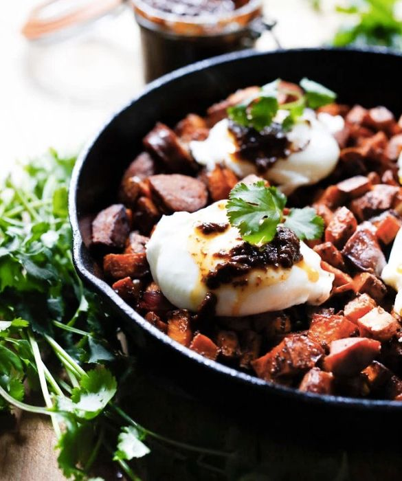 """<strong>Get the <a href=""""http://www.feastingathome.com/sweet-potato-hash-with-poached-eggs-and-harissa/"""">Sweet Potato Hash Wi"""