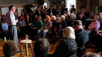 Voeters listen as Republican presidential candidate, Ohio Gov. John Kasich speaks at the town hall, Tuesday, Oct. 13, 2015, in Bow, N.H. (AP Photo/Jim Cole)