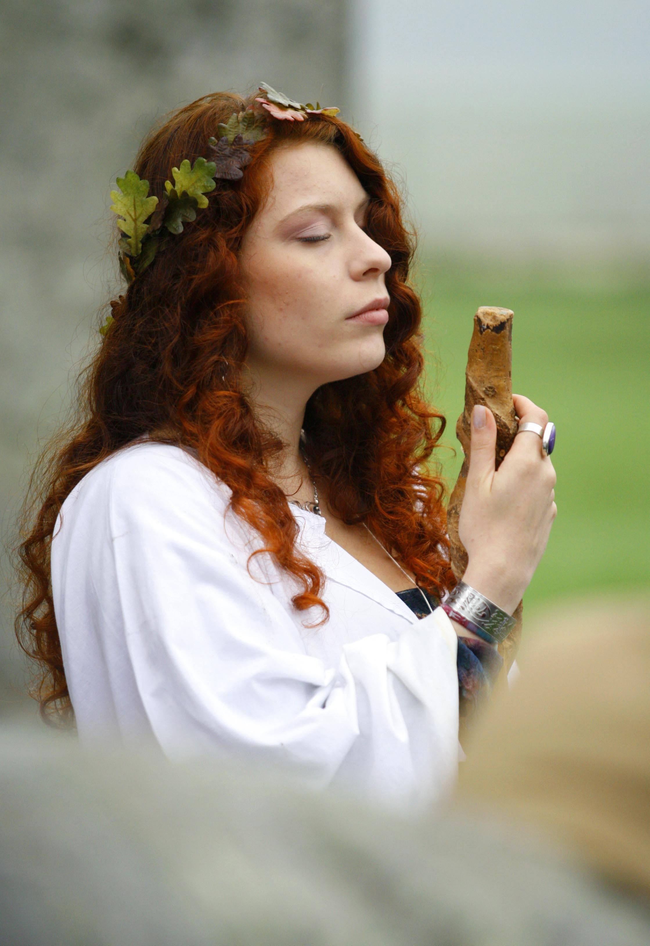 A druids performs a Samhain or pagan Halloween style blessing ceremony at Stonehenge in Wiltshire.