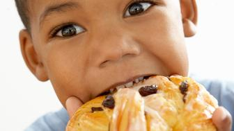 Boy eating pastry