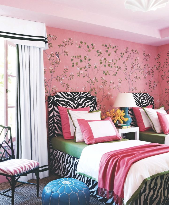 """In using the pink chinoiseriewallpaper, Gibson said he started with the paper and then added bold zebra fabric headboards. """"I thought, these two things go together. Be bold -- why not!"""""""