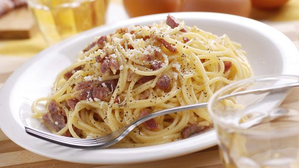 Lemon juice and zest, thinly sliced pancetta and pitted black olives give this spaghetti dish a lovely balance of tart and sa