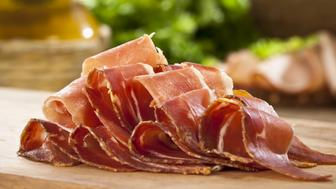 Sliced Italian Prosciutto on Wood Cutting Board