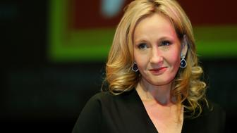 """FILE This is a Thursday, Sept. 27, 2012 file photo of British author J.K. Rowling as she poses for the photographers during photo call to unveil her new book, entitled: 'The Casual Vacancy', at the Southbank Centre in London. A lawyer who let slip J.K. Rowling's secret thriller-writer identity has been fined 1,000 pounds ($1,645) for breaching client confidentiality rules. Chris Gossage of London law firm Russells Solicitors  which represents Rowling  told a friend of his wife that the """"Harry Potter"""" creator was author of """"The Cuckoo's Calling,"""" published last year under the name Robert Galbraith. The friend tweeted the information, and it was followed up by the Sunday Times. (AP Photo/Lefteris Pitarakis, File)"""