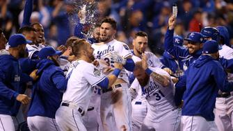 KANSAS CITY, MO - OCTOBER 27:  Eric Hosmer #35 of the Kansas City Royals celebrates with teammates after defeating the New York Mets 5-4 in Game One of the 2015 World Series at Kauffman Stadium on October 27, 2015 in Kansas City, Missouri.  (Photo by Doug Pensinger/Getty Images)