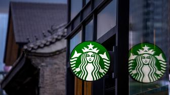 CHENGDU, SICHUAN PROVINCE, CHINA - 2015/09/13: Logo of Starbucks, with the backgrounds of Chinese ancient architecture.  China is Starbucks's fastest-growing market, expected to top 3,400 stores by 2019. (Photo by Zhang Peng/LightRocket via Getty Images)