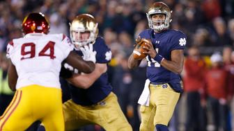 SOUTH BEND, IN - OCTOBER 17: DeShone Kizer #14 of the Notre Dame Fighting Irish looks to pass against the USC Trojans in the first half of the game at Notre Dame Stadium on October 17, 2015 in South Bend, Indiana. (Photo by Joe Robbins/Getty Images)