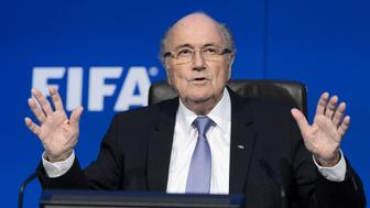 FIFA president Sepp Blatter gestures during a press conference at the football's world body headquarter's on July 20, 2015 in Zurich. FIFA said today that a special election will be held on February 26 to replace president Sepp Blatter. AFP PHOTO / FABRICE COFFRINI        (Photo credit should read FABRICE COFFRINI/AFP/Getty Images)