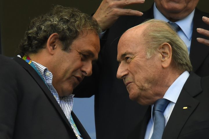 Blatter (right) speaks with UEFA president Michel Platini at the Fonte Nova Arena on June 16, 2014, during the 2014 FIFA Worl