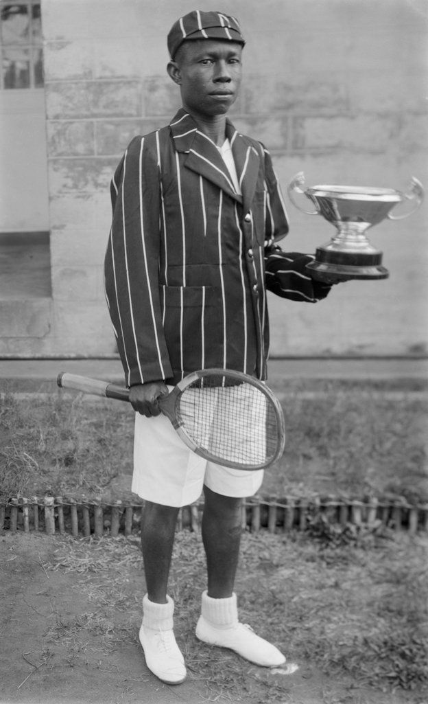 Boy with tennis racquet and trophy