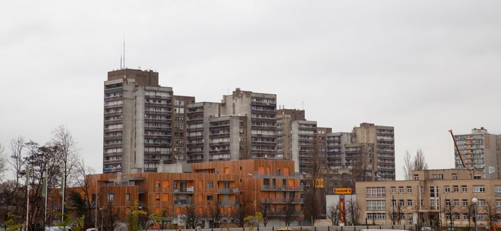 New council flats in front of shabby apartment houses from the 1960s and 1970s in Clichy-sous-Bois.